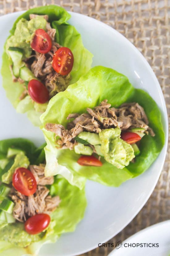 Paleo/Whole30 carnitas that are a blend of soft shredded pork, tomatoes and cucumbers