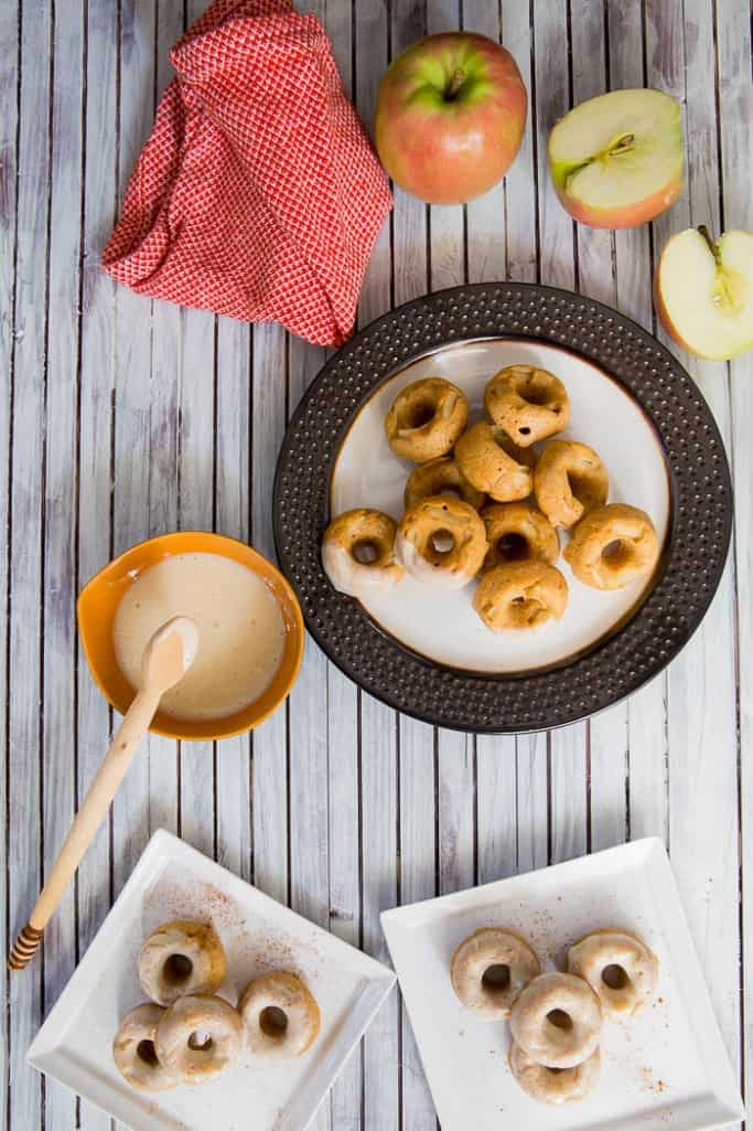 Baked mini apple donuts with apple cider yogurt glaze are a handy treat for your fall tailgates -- especially because they're made with Chobani Greek yogurt!
