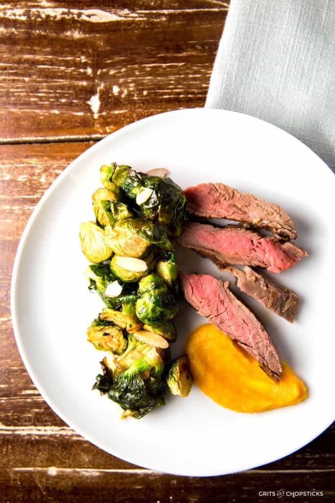 Roasted Brussels sprouts with Gochujang glaze, miso-marinated steak and Butternut squash puree