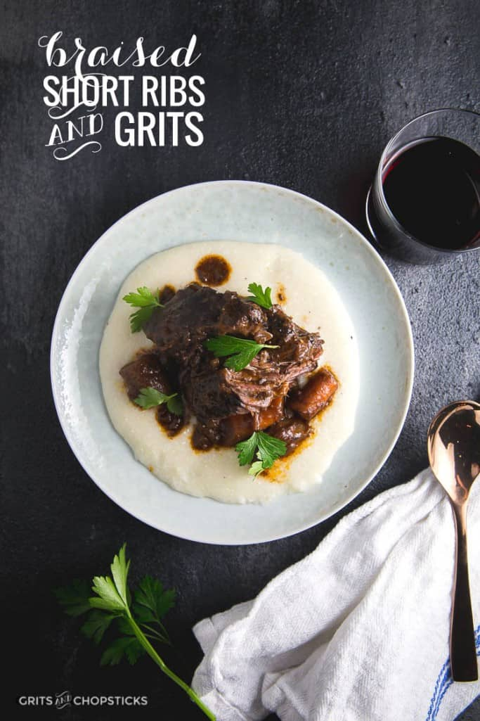 Braised beef short ribs in red wine with carrots over grits