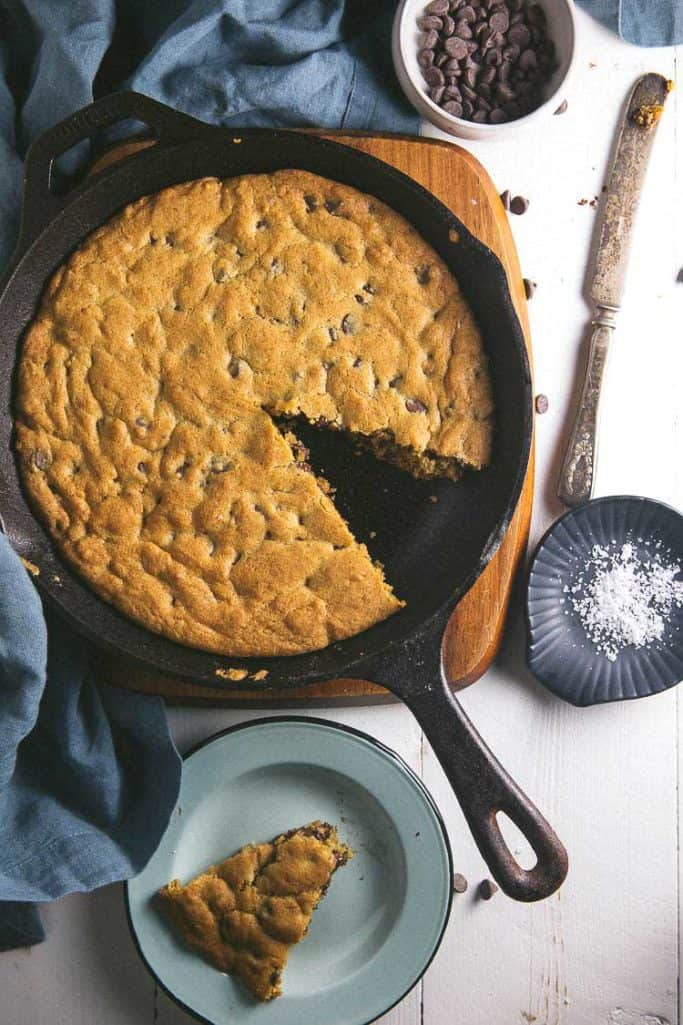 This cast iron chocolate chip cookie has flake salt and brown butter for an extra caramely, sweet/savory twist. Make it tonight!