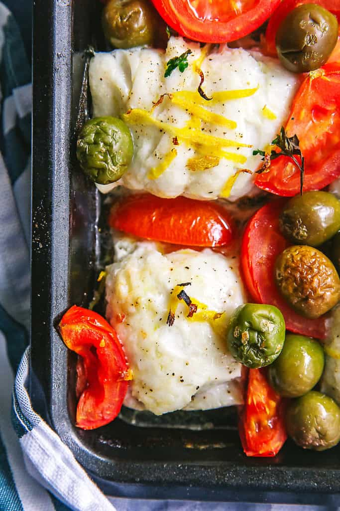 This roasted haddock with tomatoes and olives can be made in one pan. It's salty and sweet and super easy! Whole30/paleo too!