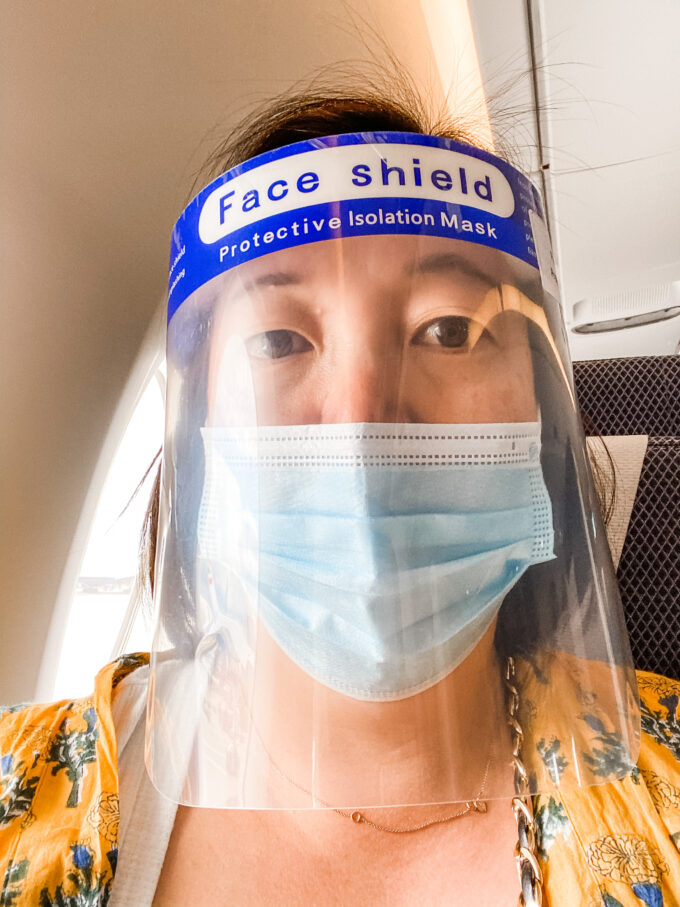 face shield face mask photo of woman during COVID-19